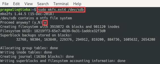 Terminal screenshot that shows the output of running the mkfs.ext4 command for formatting the USB drive with the EXT4 file system format