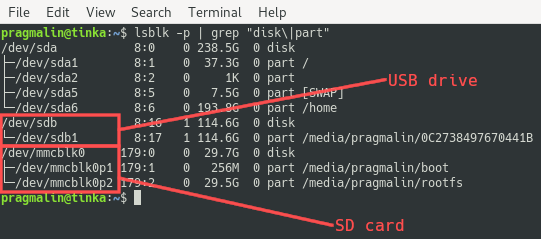 Terminal screenshot that lists the disks and partitions with the lsblk command. It shows how to identify the device names that Linux assigned to the SD card and the USB drive.
