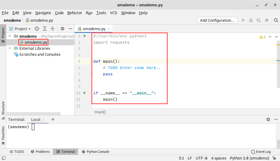 PyCharm IDE screenshot. It shows how to create a new file called smsdemo.py and how to enter the program's framework code. It will be used as a test program starting point to send an SMS message from Python.